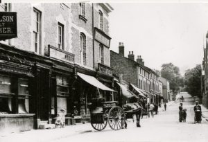 Rose Mount, 1908, showing the premises of Wilsons, family butcher, Rowlands, fishmonger, and Landers, Oxton Stores